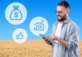 Fototapeta Millennial businessman using digital tablet while working on farm obraz
