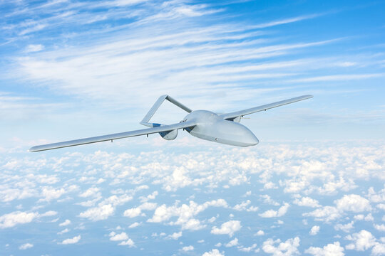 Unmanned aerial vehicle flying high in the sky above the clouds, mission.