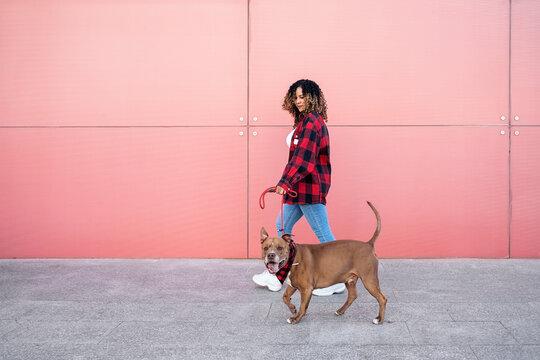African Woman Walking her Dog
