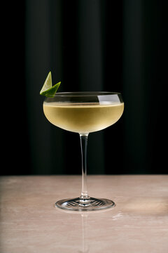 Refreshing alcohol cocktail in classic glass served on table