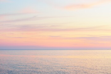 Obraz Baltic sea at sunset. Dramatic sky, blue and pink glowing clouds, soft golden sunlight, midnight sun. Picturesque dreamlike seascape, cloudscape, nature. Panoramic view - fototapety do salonu