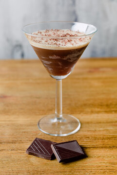 Glass of Mocha Martini with pieces of chocolate