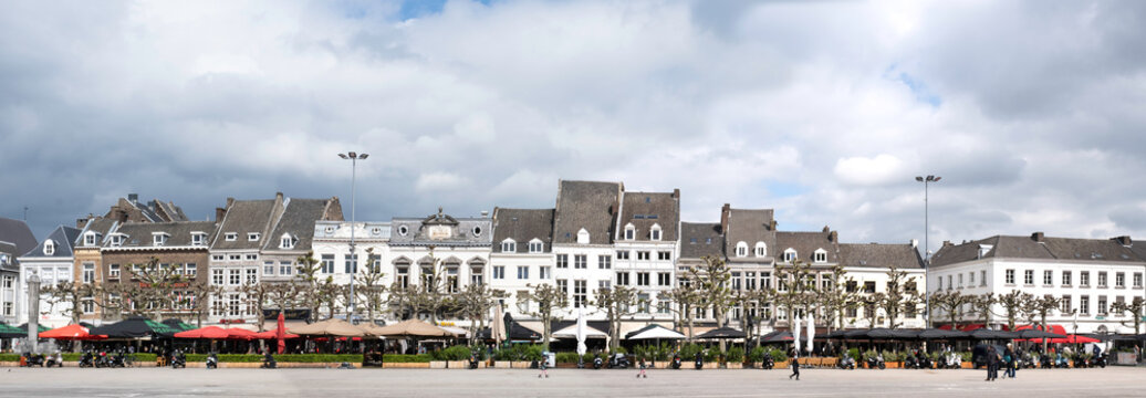 021: Cafés and restaurants with beautiful facades and terraces on the Vrijthof, the largest square in the city center of Maastricht, the Netherlands. Widescreen photo