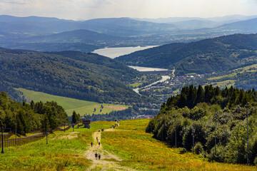 Panoramic view of Beskidy Mountains surrounding Zywieckie and Miedzybrodzkie Lake seen from Gora Zar mountain near Zywiec in Silesia region of Poland