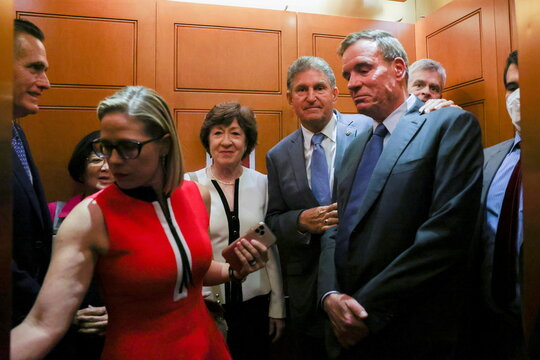 U.S. senators depart after bipartisan work group meeting on infrastructure legislation at the U.S. Capitol in Washington