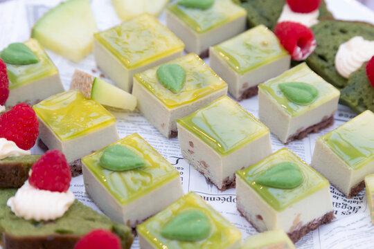 Dessert buffet where green cake looks delicious