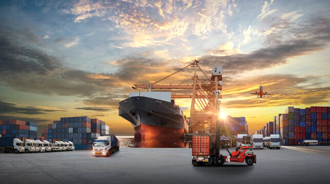 Container truck in ship port for business Logistics and transportation of Container Cargo ship and Cargo plane with working crane bridge in shipyard at sunrise, ฺ Business logistic import export