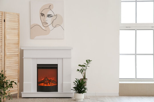 Stylish fireplace in interior of living room