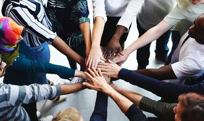 Fototapeta Diversity teamwork with joined hands obraz