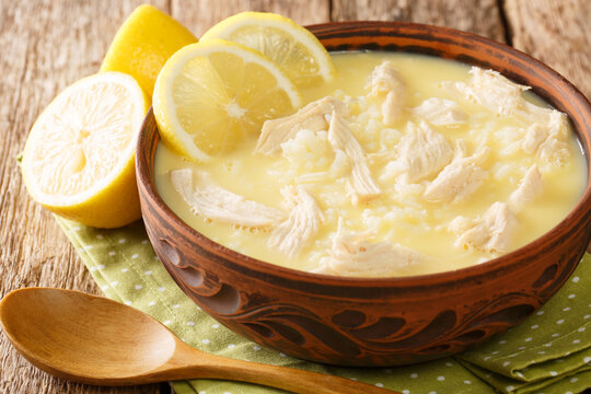 Kotosoupa Avgolemono recipe is a Greek chicken lemon soup that's comforting and full of fresh flavors close up in the plate on the table. Horizontal