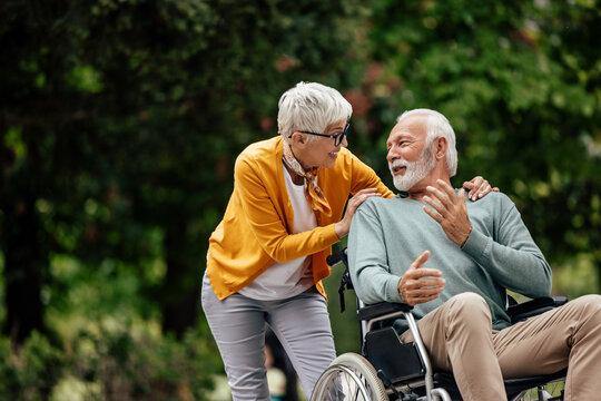 Senior woman, having fun with her husband.