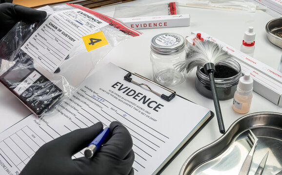 Forensic police take data from a phone involved in a homicide, crime lab analysis, concept image