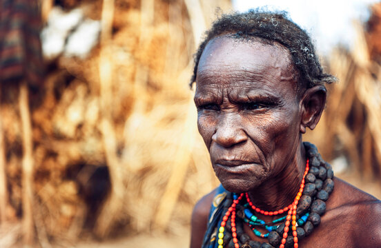 Serious senior woman from Dassanech tribe in a village, Omo vall