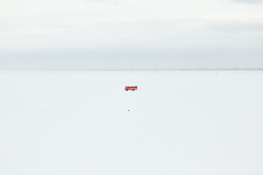 Red bus in endless winter valley