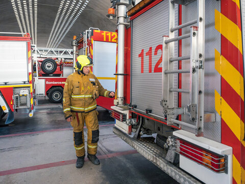 Fireman standing in fire department