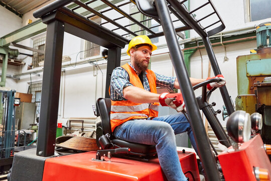 Worker as a forklift driver on the forklift