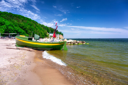 Summer scenery of the Baltic Sea with fishing boat in Gdynia Orlowo, Poland