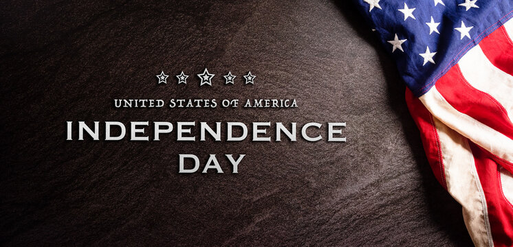 Happy Independence day: 4th of July, American flag on dark stone background with the text.