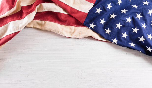 Happy Independence day: 4th of July, American flag on white wooden background.