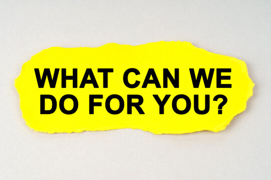On a white background lies yellow paper with the inscription - WHAT CAN WE DO FOR YOU