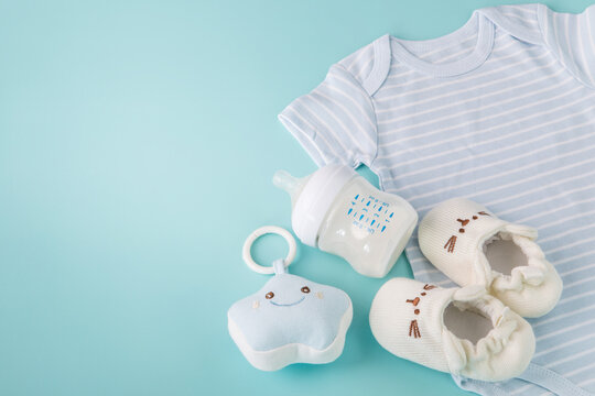 Composition with a baby accessories on light blue background , new born or baby care concept