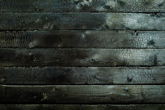 Black wooden background with scratches