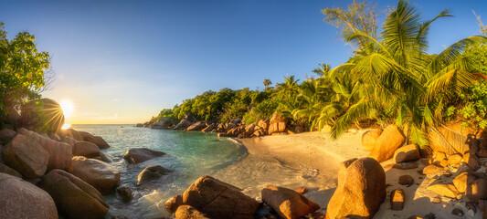 sunset at tropical beach anse lazio on praslin on the seychelles