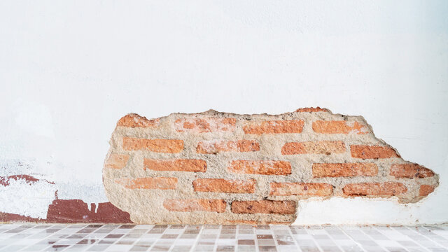 A crack of cement wall and bricks.