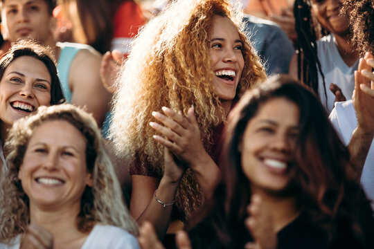 Woman watching a sport event and enjoying at stadium