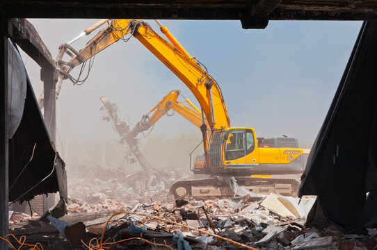 Demolators at the demolition site of the old building.