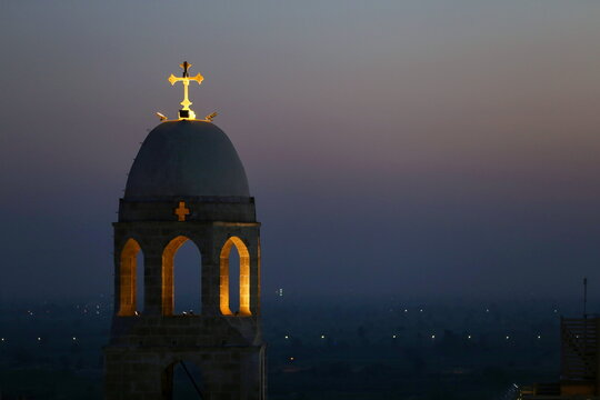 """A cross atop a church is seen during a ritual mirroring the Holy Family's """"flight to Egypt"""" at the Monastery of the Virgin Mary on Jabal al-Tair, amid the coronavirus disease (COVID-19) pandemic in Minya Governorate"""