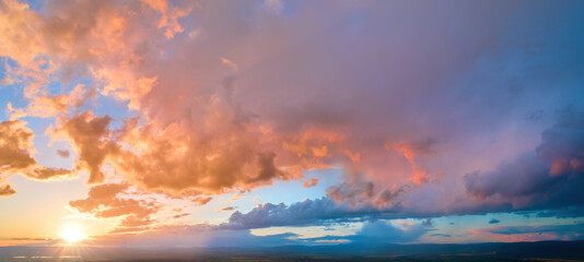 Colorful sky background sunset, illuminated pink-orange dramatic clouds, aerial photography, far horizon, setting sun. Ideal for sky replacement postproces. - fototapety na wymiar