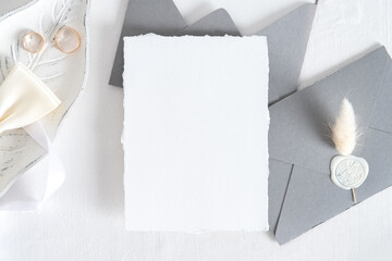 Obraz Wedding invitation card mockup, grey envelopes, rings on white background. Flat lay, top view. Minimal style. - fototapety do salonu