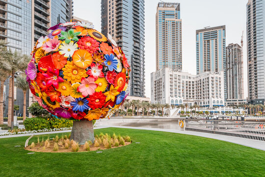 24 February 2021, Dubai, UAE: Hotels and apartment residential skyscraper buildings panoramic view with flower bouquet statue in Dubai Marina Creek Harbour