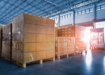 Stacked of Package Boxes Wrapped Plastic Flim on Pallets at Storage Warehouse. Shipment Boxes. Cargo Export- Import. Shipping Warehouse Logistics.