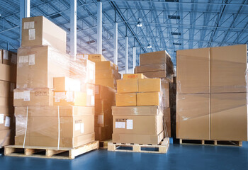 Stacked of Package Boxes on Pallets at Storage Warehouse. Shipment Boxes. Cargo Export- Import. Shipping Warehouse Logistics.