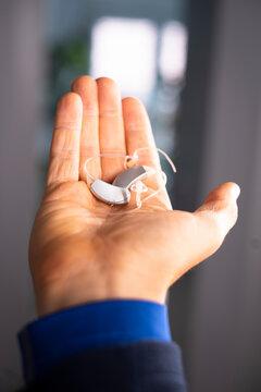 Hearing aid ear of man
