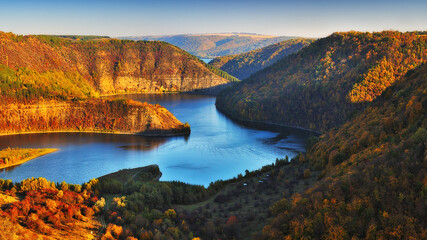 Dnister River Canyon. autumn dawn. Blue shade river. Sun shine on Mountains. picturesque landscape