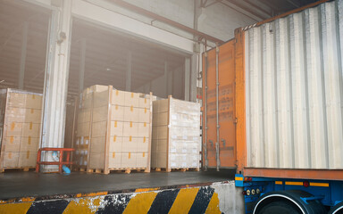 Stacked of Package Boxes on Pallet with Cargo Container. Trailer Parked Loading at Dock Warehouse. Delivery Service. Shipping Warehouse Logistics. Shipment Freight Truck Transportation.