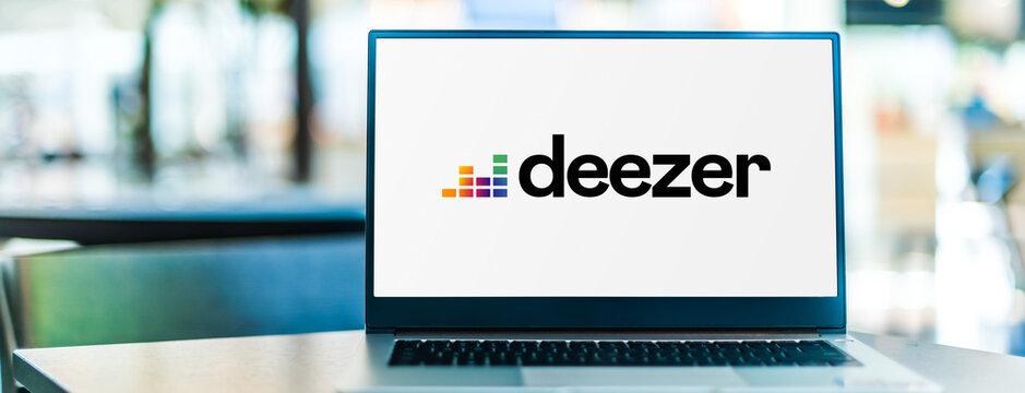 Laptop computer displaying logo of Deezer