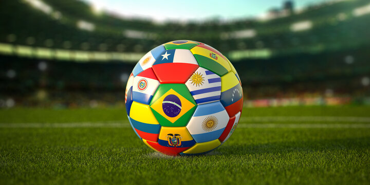 Soccer Football ball with flags of south america countries on the grass of football stadium. America championship 2021.