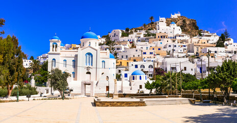 Beautiful islands of Greece - Ios , Cyclades. Whitewashed traditional houses of picturesque village Chora, view of square and church in downtown