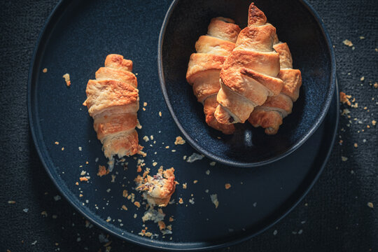 Tasty croissants made of puff pastry. Sweet french dessert.