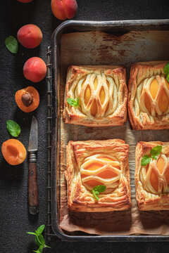 Sweet puff pastry with sugar and peaches. Unique yummy cake.