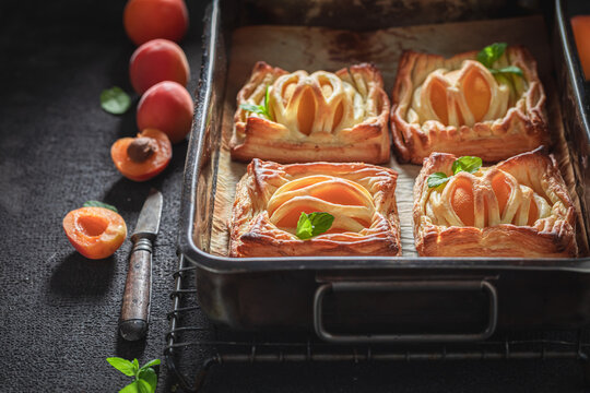 Awesome puff pastry with peaches and mint. French juicy dessert.
