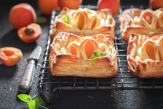 Sweet puff pastry with peaches and mint. Unique yummy cake.
