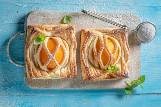 Awesome puff pastry with peaches and mint. Unique yummy cake.