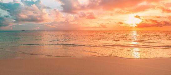 Fototapeta Closeup sea sand beach. Panoramic beach landscape. Inspire tropical beach seascape horizon. Orange and golden sunset sky calmness tranquil relaxing sunlight summer mood. Vacation travel holiday banner obraz