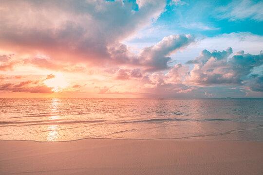 Closeup sea sand beach. Panoramic beach landscape. Inspire tropical beach seascape horizon. Orange and golden sunset sky calmness tranquil relaxing sunlight summer mood. Vacation travel holiday banner