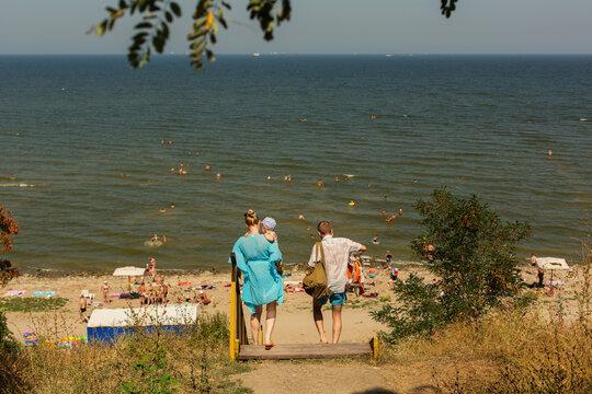 RUSSIA, YEYSK - 20 August 2016: Wooden stairs to the Kamenka beach with people. Russia, Sea of Azov, Krasnodar Territory, Yeysk.